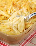 World's Best Mac and Cheese - Martha Stewart Recipes Butter or vegetable oil, for baking dish 6 ounces penne 2 cups Beecher's Flagship Cheese Sauce 1 ounce cheddar cheese, grated (1/4 cup) 1 ounce Gruyere cheese, grated (1/4 cup) 1/4 to 1/2 teaspoon chipotle chile powder