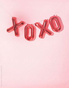 "Bachelorette party decor idea - ""XOXO"" balloons {Courtesy of Stocksy United}"