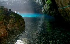 Picture of melissani lake taken from the cave entrance