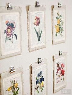 Let your walls bloom with beautiful homemade artwork. Find free botanical images online and print them on old book pages. To create a textural mat, cut linen a little larger than the page and machine stitch 1/4 inch from all edges. Fray the edges by pulling out threads down to the stitched line. Machine-stitch the page to the linen mat, then hang using bulldog clips. #HomemadeWallDecorations,