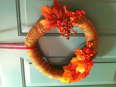 Fall wreath. {pool noodle+duct tape+yarn+dollar tree fake leaves & berries on wire}