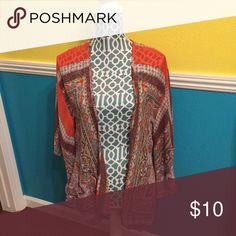 Pink and orange floral kimono Paisley and floral patterned sheer pink and orange kimono. Super cute to go over tank tops and dresses! Hardly worn and in great condition! Jackets & Coats