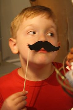 Get a bunch of prop moustaches and take photos at a birthday party.  Adults love it too.