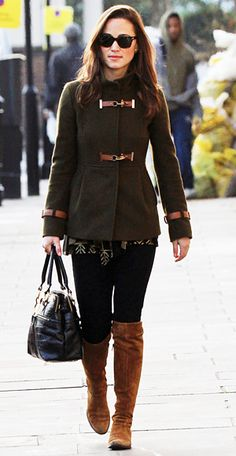 Pippa Middleton kept warm in an army green Fay funnel coat, black jeans, and brown boots. She accessorized with her handy Modalu snakeskin black bag.
