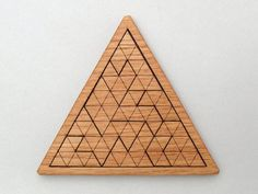This laser cut triangles jig saw puzzle is made from sustainably harvested, solar-kiln dried, and locally grown Oak. This moderate difficulty puzzle includes a laser engraved cheat sheet on the bottom of the puzzle, which makes it hard even for the cheaters! This geometric shapes