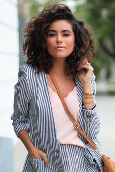 Blogger Sazan Hendrix lets her natural brunette curls shine in this curly lob