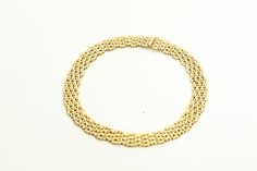 GOLD CHOKER NECKLACE.  European, 20th century. 18k yellow gold necklace in a woven link pattern. Sold at Garth's Auctions on December 9, 2015 for $2,520.