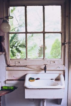 : Beautiful window, amazing sink, and wonderful light fixture. :