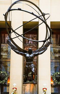 You can see a famous bronze statue of Atlas in front of Rockefeller Center. In Greek mythology, Atlas was forced by Zeus to hold up the heavens as a special punishment – as we can see on this photo.