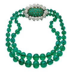 Two-Strand Graduated Emerald Necklace gathered by an oval-shaped bombé clasp set with emeralds in a diamond-set foliate surround, mounted in platinum and gold