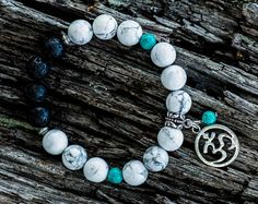 CALM | A beautiful, unique, semi precious gemstone DIFFUSER BRACELET for use with AROMATHERAPY essential oils. This bracelet is made using 10mm Howlite and 6mm Turquoise beads with porous lava beads that may be used with essential oils. It is threaded on clear stretch elastic and you can choose your own charm.  This bracelet is available in multiple sizes.