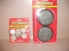 FURNITURE SUPER SLIDERS. TWO PACKAGES. MIXED SIZES. NEW IN PACKAGE