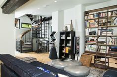 The spiral staircase in the library leads to the master suite at Mission House.