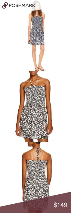 Tory Burch Black Orchard Dress Our Orchard Smocked Dress is done in a graphic floral — made ultra-wearable in classic black and ivory. Perfect for days on the sand or in the city, this effortless look can be styled two ways: with the adjustable ties fastened around the neck or knotted at the front, creating a strap-free silhouette. It's cut from a soft, lightweight fabric that resists wrinkles and has a waist-defining stretch bodice for a chic and flattering fit. Adjustable string ties at…