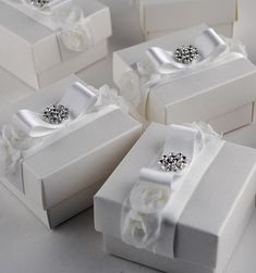 Exclusive handmade favour boxes and gorgeous luxury wedding stationery handcrafted in the UK by Wedding Invitation Boutique. Established 2006.