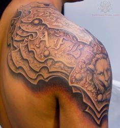 Shoulder armor tattoo design inspiration