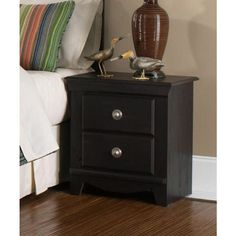 Carlsbad features a modern style through a blend of clean lines and simple adornments. Wood and wood products with simulated wood grain laminates. Group may contain plastic parts. French dovetail drawer construction with roller side drawer guides. color finish. Dark, Pecan color with a rubbed-through appearance Surfaces clean easily with a soft cloth.