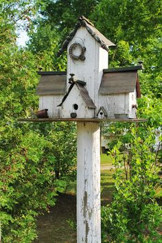 Rustic Garden Birdhouse..with many mini houses attached to it.