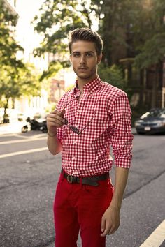 Shop this look on Lookastic:  https://lookastic.com/men/looks/white-and-red-gingham-dress-shirt-red-chinos-dark-brown-leather-belt/12839  — White and Red Gingham Dress Shirt  — Dark Brown Leather Belt  — Red Chinos
