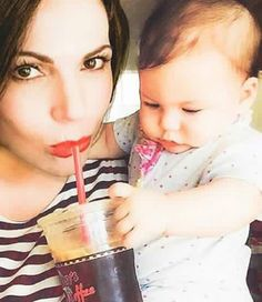 Awesome Lana holding an adorable baby girl drinking iced tea #Vancouver BC 2015
