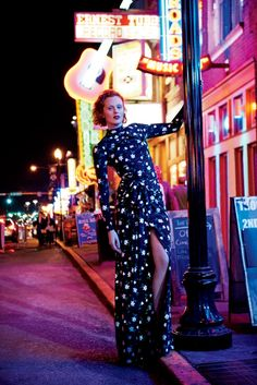 Posing on the streets of Nashville, Karen Elson flaunts her leg in a Carolina Herrera dress 2016 Campaign