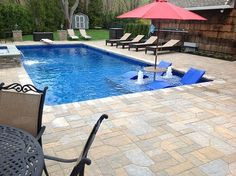 Scott Birkmaier, president of The Big Splash in Setauket, N.Y., remodeled his own pool to accommodate more lounging and splashing for his family. He didn't use steel for the tanning ledge and interior stairs. Instead, he opted for vinyl-covered accoutrements formed of concrete.