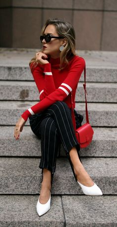 Red striped turtleneck sweater, pinstriped stirrup ski pants, white leather slide pumps, red leather shoulder bag, black cat eye sunglasses, silver disc earrings {3.1 Phillip Lim, Maggie Marilyn, Madewell, Nico Giani, Louise et Cie, Aprés ski style, fall winter 2017 trends, fall trends, classy style}