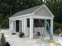 pool house- front is sliding glass doors with pergola built off of it facing the pool.  Side facing yard is bar
