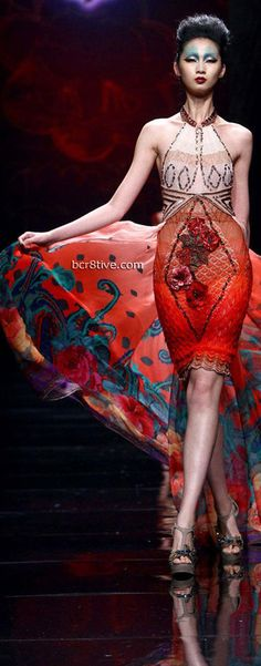 China: ill show there is both red and blue in this outfit.  It is a real statement piece and I love how it shows how red can show confidence and beauty.
