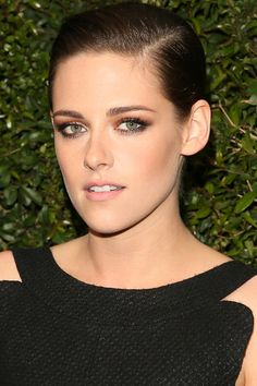 When in doubt, go for lots of shine and a pulled back updo. Smoky eyes à la Kristen Stewart are perfect for a night out.   - HarpersBAZAAR.com