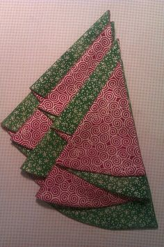 Finished folded napkins looks like a Christmas tree.                    To complete 8 napkins you will need 2 yards of fabric,1 yard of ea...