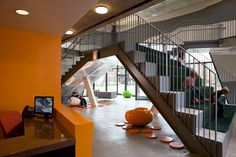 great dual staircase, one meets egress requirements and the other meets program functions  SOS Children's Village Lavezzorio Community Center - Building Types Study - Architectural Record