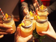 Lavender Lemon Drop cocktail in mason jars for our Spring Fling Dinner Party. Click to see how you can replicate this cocktail for your party at home! #unsocialsocialite #dinnerparty #springfling #lavender #lemondrop #foodgasm #redstraws #masonjars #toasttospring