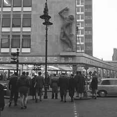 """Marks & Spencer Edgware Road. What happened to """"Progression"""" the wall figure?  M&S opened at 258-264 Edgware Road, on October 1959. An architect commissioned a sculptor to make a large figure for M & S. He was asked to cover as much of the wall space as possible to cover an unfortunate discolouration of the wall cladding, This was Edward Bainbridge Copnall MBE (29 August 1903 – 18 October 1973) sculptor and painter. This was chosen it was 25 ft high made from fibre glass."""