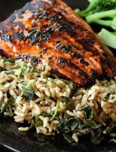 Summer Salmon Over Cilantro-Lime Rice with Kale 4 tbsp lime juice, separated 1 tsp dried cilantro 1 tbsp honey 2 salmon fillets About lb raw kale chopped scallions diced 2 cups of cooked brown rice. About cup fresh cilantro Kosher Salt Salmon Recipes, Fish Recipes, Seafood Recipes, Great Recipes, Cooking Recipes, Favorite Recipes, Healthy Recipes, Cookbook Recipes, Cooking Tips