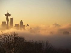 Morning Fog around Skyline with Sihouette of Space Needle and City Buildings Photographic Print