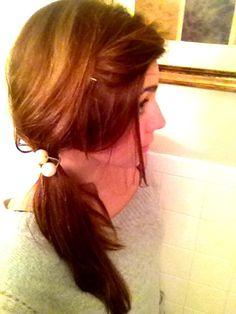 Messy low ponytail.