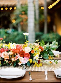 Full, leafy arrangements on the tables