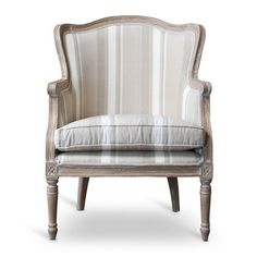 Defined by neutral-toned striping and delicately carved details, this lovely arm chair lends a touch of simple sophistication to your parlor or den.