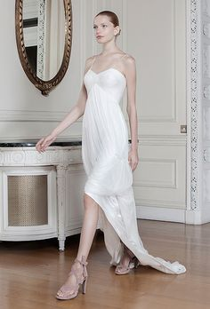 "Brides.com: . ""Athena"" sleeveless high-low silk and chiffon sheath wedding dress with a v-neckline, spaghetti straps, and an empire waist, Sophia Kokosalaki"