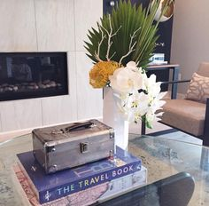 Great tip: Do you know the luggage accessory box in this photo keeps all of the remotes and coasters for a clean look and functional space!