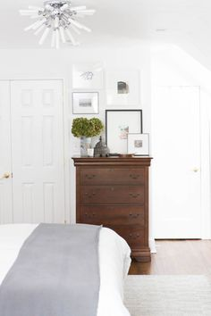 Photography: Edward Underwood Photography - www.edwardunderwood.com Read More on SMP: http://www.stylemepretty.com/living/2016/11/10/the-genius-ikea-hack-that-totally-makes-this-revamped-master-bedroom/