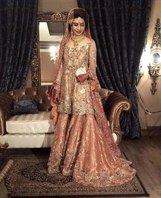 We love the timeless charm of traditional brides! Humera in on her wedding day looks gorgeous in a chai pink and scarlet red combination! Asian Bridal Dresses, Asian Wedding Dress, Pakistani Wedding Outfits, Bridal Outfits, Pakistani Dresses, Walima Dress, Shadi Dresses, Pakistan Bride, Pakistan Wedding
