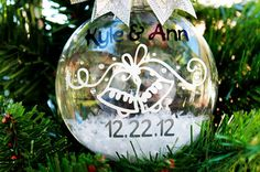 Personalized Wedding Ornament...I NEED something like this for our first christmas as a married couple.