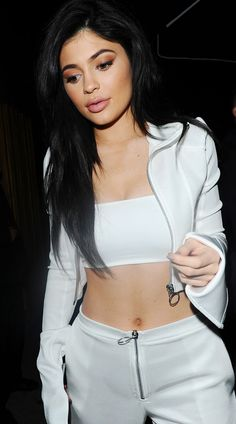 Not *everyone* is sold on Kylie Jenner's white zip-up trousers...