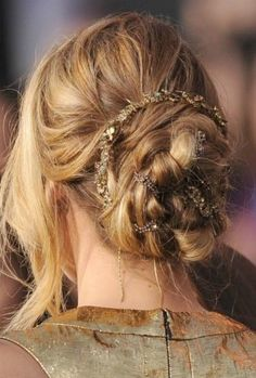 Jennifer Lawrence - not a fan of the giant chunks of hanging hair, but I LOOOVE the twisty bun with the sparklies!