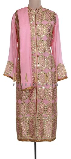 Buy Online from the link below. We ship worldwide (Free Shipping over US$100). Product SKU - 301012. Product Link - http://www.kalkifashion.com/pink-semi-stitched-suit-adorn-in-mirror-and-gotta-patti-lace-only-on-kalki.html