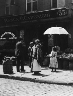 Snapshot of life: A vegetable stand and the post office on 55 1/2 to 57 Mulberry Street, Little Italy, circa 1890.