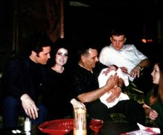 Priscilla's father holding Lisa (also in photo her brother, sister and Elvis