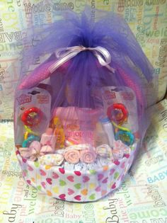 I made this!!! Diaper basket made from diapers and receiving blankets and wash clothes